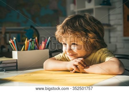 Cute Face Of Pupil, Close Up. Pupil Learning Letters And Numbers. Children Learning. Cute Child Boy