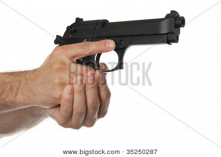 Two Hands Holding A Gun With Finger Off The Trigger