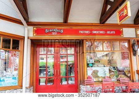 Banff, Canada - Feb 15, 2020 : Famous Canadian-based Beavertails Restaurant With Its Sign On Busy Ba