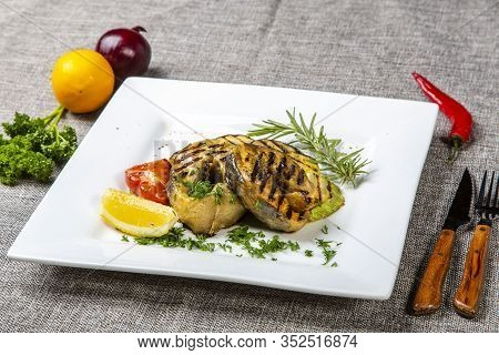 Sturgeon Steak With Vegetables. Delicious Sturgeon Steaks Are Grilled And Served On A White Square P