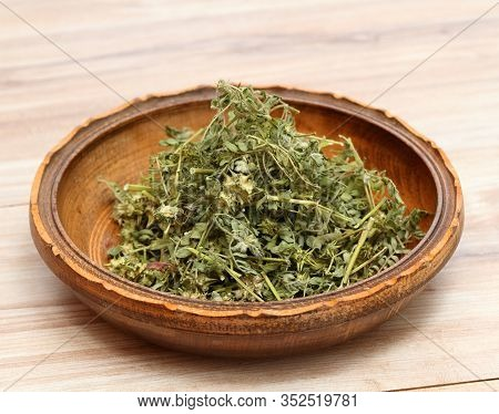 Dried Tribulus Terrestris In The Bowl.  Curative Herb Tribulus Terrestris And  Its Seeds Called Devi