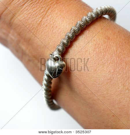 The Bracelet With Heart On Hand.