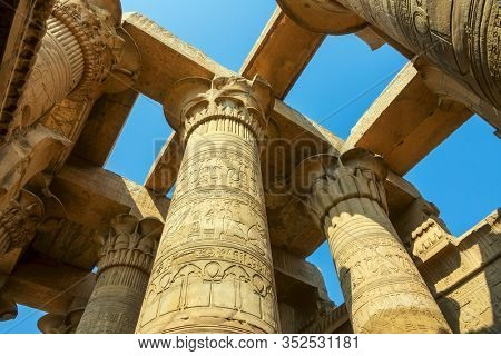 Ancient pillars with hieroglyphics at the temple of Kom Ombo, Egypt