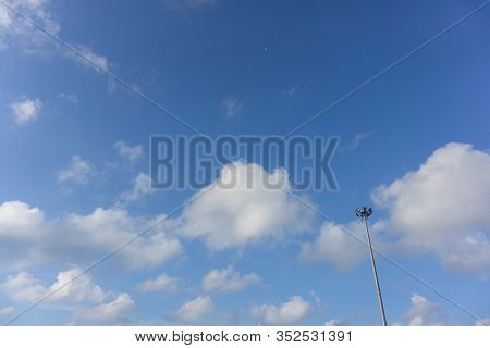 Light Pole Bright Have Spotlight With Blue Sky With Clouds Background. Beautiful White Fluffy Clouds