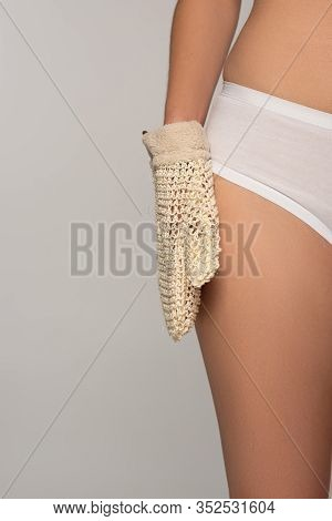 Cropped View Of Woman With Perfect Skin Holding Exfoliation Glove, Isolated On Grey