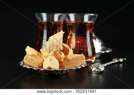 Bowl With Pieces Of Turkish Delight Lokum And Black Tea. Creative Photo.