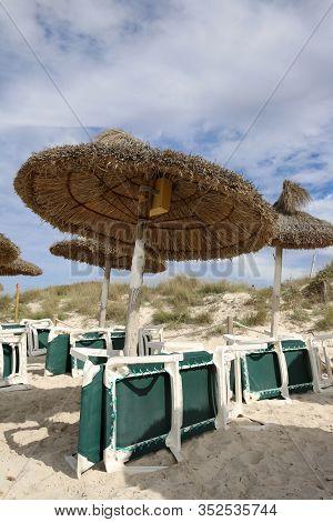 Deck Chairs And Umbrellas On Es Trenc Beach Near Ses Salines. Majorca. Spain