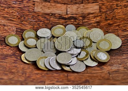 Mahe Island, Seychelles. November 17th 2020: Seychelles Rupees, Coins With Wooden Background. Centra
