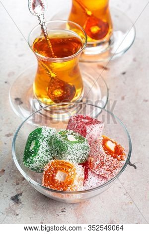 Various Pieces Of Turkish Delight Lokum And Black Tea
