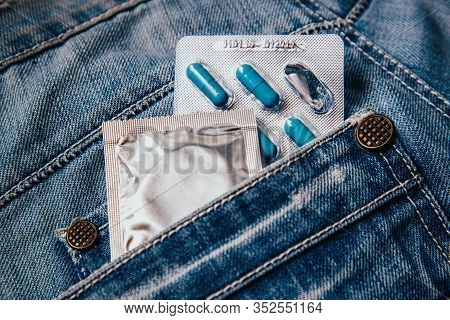 A Pack Of Blue Capsules In Your Pants Pocket And A Condom. Pills For Mens Health And Sexual Energy I