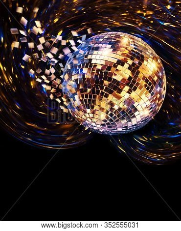 Vintage Disco Mirror Ball Spinning And Breaking Into Blue And Golden Flying Glass Fragments On Dark