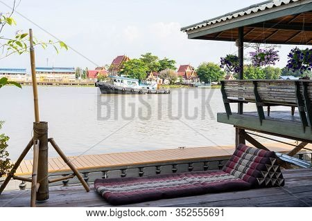 A Pad Or Cushion In Thai Lanna Style In Northern Culture Of Thailand In Front Of Traditional Thai Ho