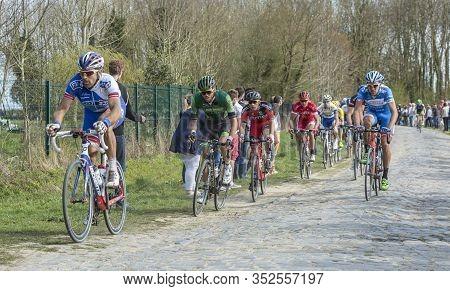 Gruson, France - April 12,2015: The Peloton Riding During Paris-roubaix Race In 2015.