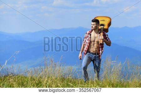 Hits You Love. Happy And Free. Cowboy Man With Bare Muscular Torso. Acoustic Guitar Player. Country