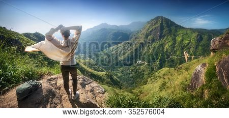 Happy Woman Traveler Enjoying Early Morning Beautiful Nature On The Background Of The Famous Mountai