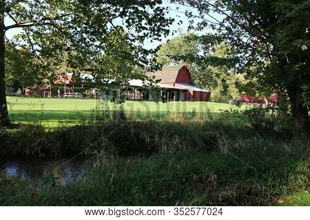 Midwest Farm Barn Buildings Next To A River