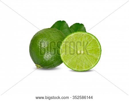 Whole And Hafl Cut Ripe Green Lime With Leaves On White Background