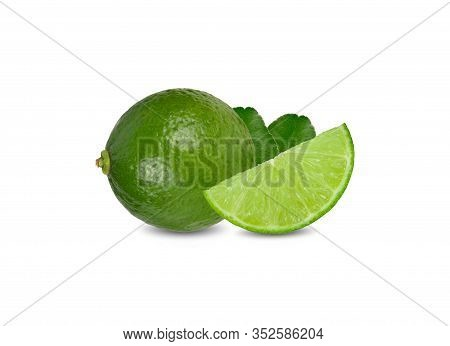 Whole And Sliced Ripe Green Lime With Leaves On White Background
