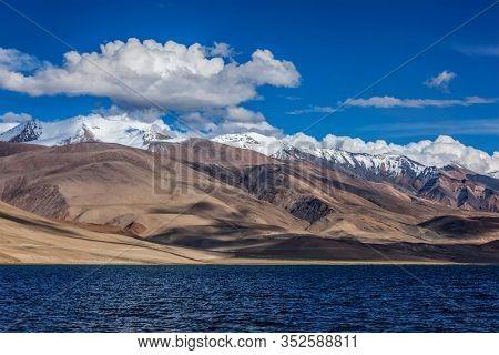 Himalayan nature high altitude lake Tso Moriri (official name Tsomoriri Wetland Conservation Reserve) on sunset with shadows from clouds, Korzok, Changthang area, Ladakh, Jammu and Kashmir, India