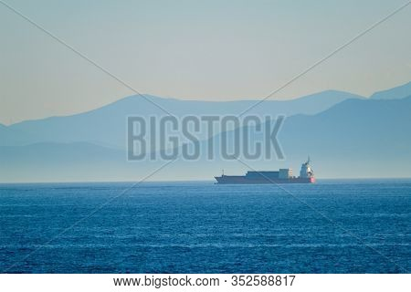 Cargo vessel ship in Aegean Sea Mediterranean sea. Greece