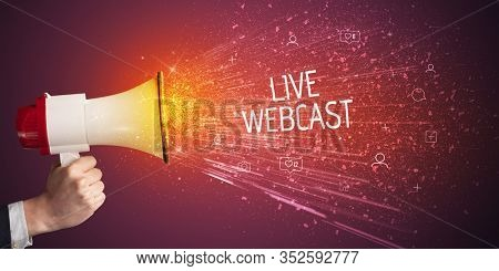 Young woman yelling to loudspeaker with LIVE WEBCAST inscription, social networking concept