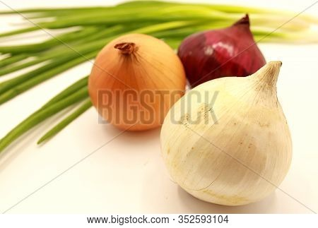 Green Onion Feathers, Black And Purple Onions, Yellow Onions And White Onions Isolated On White Back