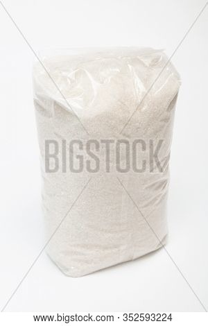transparent bag with sugar on a white background