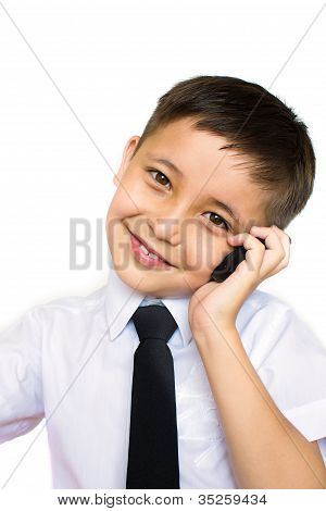 A Little Boy Talking On The Phone
