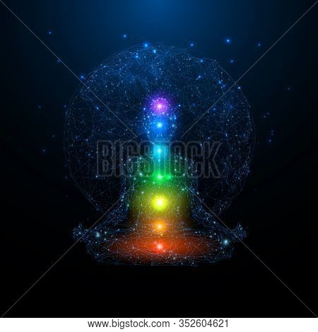Yoga Space Concept. Young Woman Seats In A Lotus Position. Colorful Chakras On Body On Blue Earth Pl