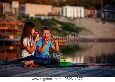 Two Young Cute Little Friends, Boy And Girl Talking, Drinking Tea, Eating Sandwiches And Fishing On