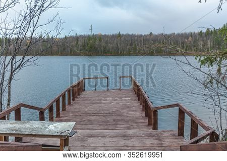 Pier On The Lake. Sami, Saami Village On The Kola Peninsula, Russia. Tourist Ethnographic Parking. S