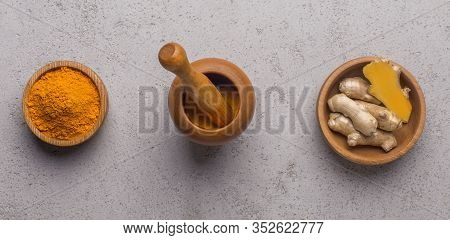 Turmeric Peeled Root And Turmeric Powder In Wooden Bowls On Concrete Background, Healthy Curcumin, P