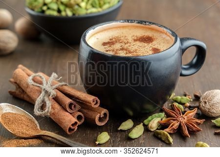 Cup Of Healthy Ayurvedic Masala Tea Or Coffee, Hot Chocolate With Aromatic Spices. Cinnamon Sticks,