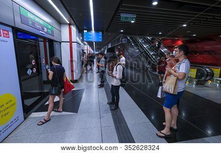 Passenger Waiting For Mass Rapid Transit (mrt) Train At Bukit Bintang Station