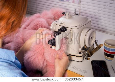Professional Master In The Manufacture Of Clothing From Fur. Woman Couturier At The Sewing Machine,