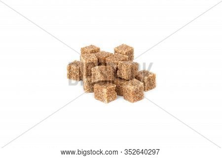 Cane Sugar On A White Background. Cane Sugar Cubes Close Up.
