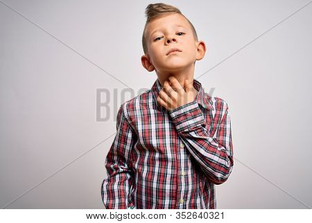 Young little caucasian kid with blue eyes wearing elegant shirt standing over isolated background Touching painful neck, sore throat for flu, clod and infection