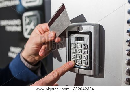 Man Scanning Security Key Card On Electric Lock And Entering Security System Code To Entry Private B