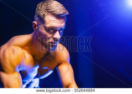 Portrait Of A Sexy Young Athletic Sport Fair-haired Man With A Naked Torso.