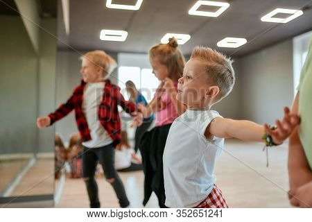 Modern Dancers. Group Of Fashionable Children Learning A Modern Dance While Having A Choreography Cl