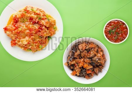 Stewed Tomatoes With Onions In A White Plate On A Lime Background. Stewed Tomatoes With Onion Top Vi