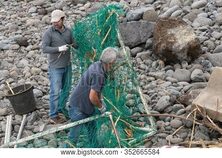 Ponta Do Sol, Portugal - March 1, 2018: Local Volunteer People Cleaning The Beach After A Storm In P