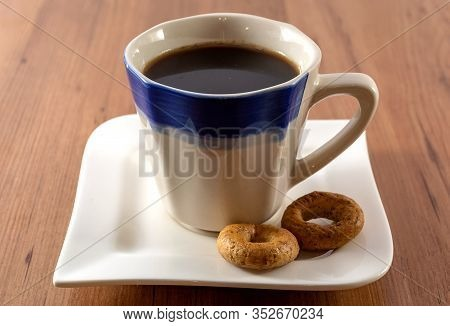 Breakfast At The Cafe. On The Glass Table Dirty Dishes - A Coffee Cup And A Plate With Crumbs From E