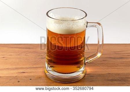 Light Beer Mug Against The Backdrop Of The Bar Shelf
