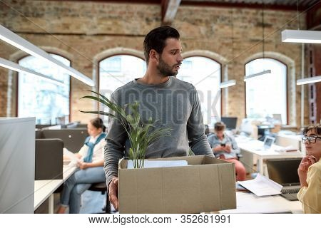 If You Dont Like Your Job Quit. Upset Man In Casual Wear Holding Box With Things And Leaving The Off