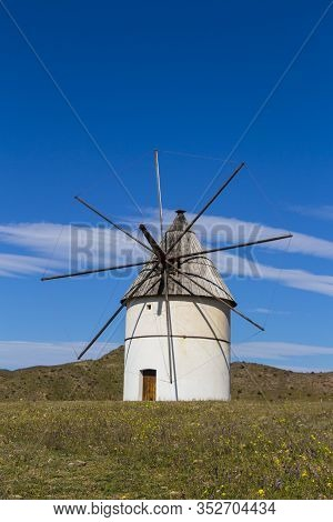 Old Windmill Traditional In Spain, Pozo De Los Frailes, Province Of Almeria, Windmill Under Blue Sky