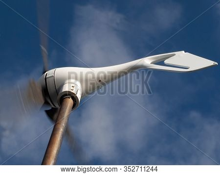 Wind Generator Generating Alternative Energy In A Nautical And Marine Environment On A Yacht At Sea.