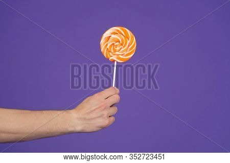 Sweet Trap. Lollipop Close Up. Hand Hold Lollipop. Sweet Gift. Gift For Romantic Holiday Valentines