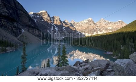 Wide Angle View Of Moraine Lake On A Clear Summer Morning In Canada