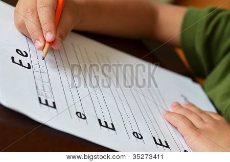 Education Concept With Child's Hand Learning To Write